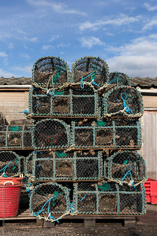 Lobster, Crab and Crayfish traps stacked  to dry outside a fisherman's  hut by Paul Phillips for Stocksy United