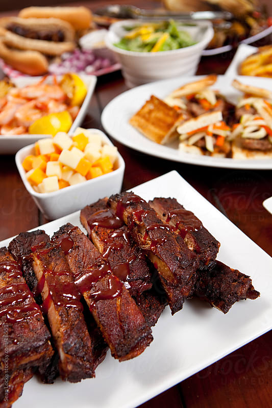 Tailgate Food: Focus on Smoked Pork Baby Back Ribs by Sean Locke for Stocksy United