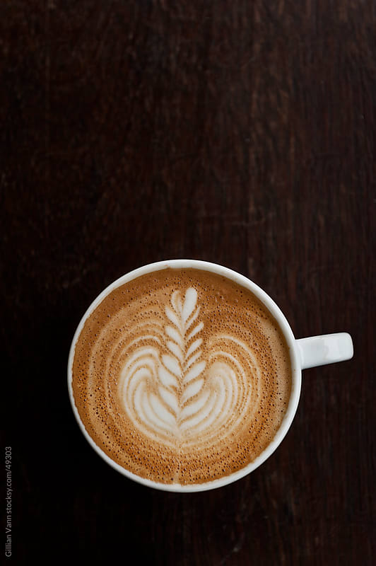 flat white coffee with latte art by Gillian Vann for Stocksy United