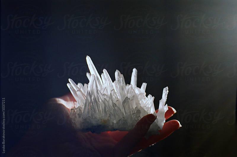 Woman holding a crystal by Lyuba Burakova for Stocksy United