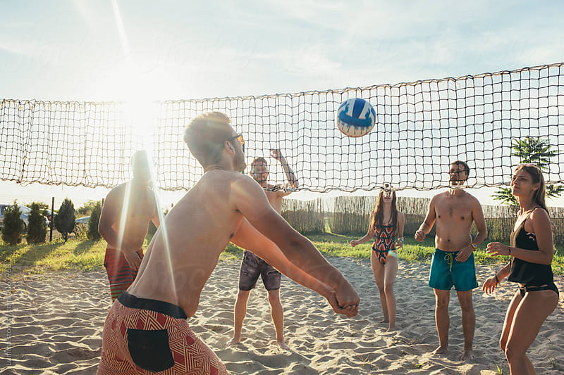 Group of Young People Playing Beach Volleyball