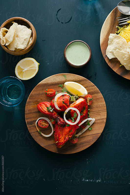 Tandoori chicken by Alita Ong for Stocksy United