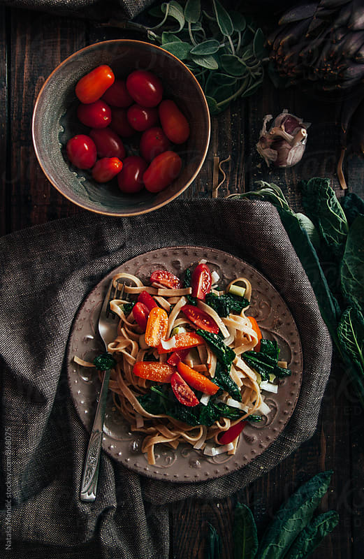 Pasta with kale and cherry tomatoes by Nataša Mandić for Stocksy United