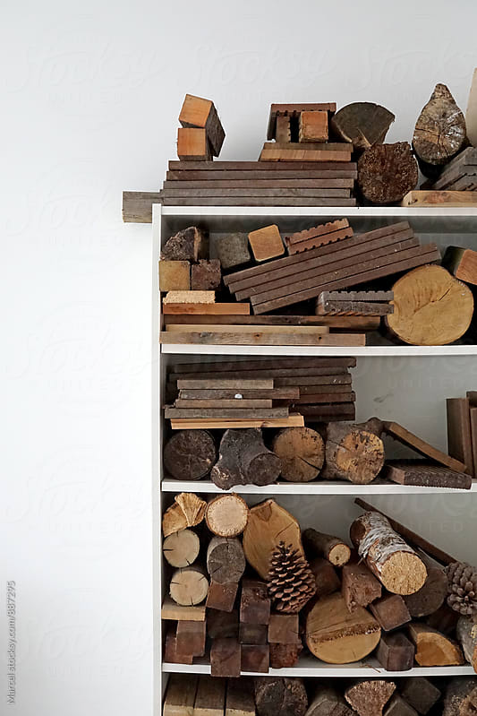 Firewood in a cupboard by Marcel for Stocksy United