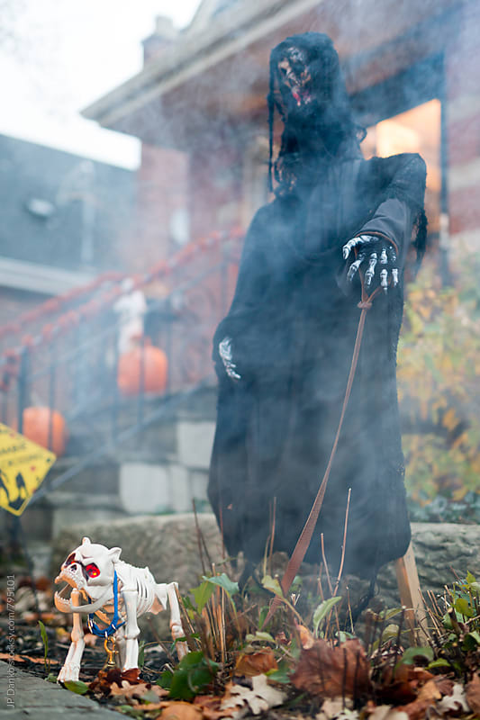 Scary Grim Reaper and Skeleton Dog Halloween Decorations on House Walkway by JP Danko for Stocksy United