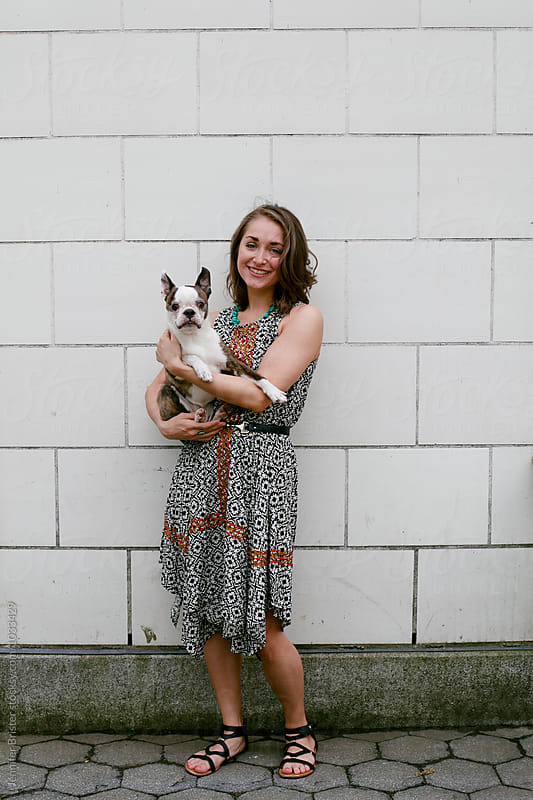 Woman holding dog  by Jennifer Brister for Stocksy United