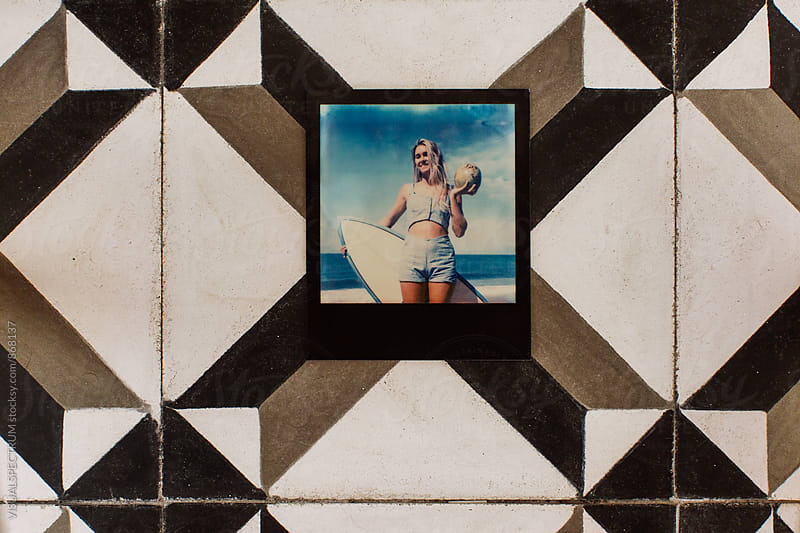 Polaroid of Young Blond Surfer Woman Holding Fresh Coconut on Vintage Tiles by VISUALSPECTRUM for Stocksy United