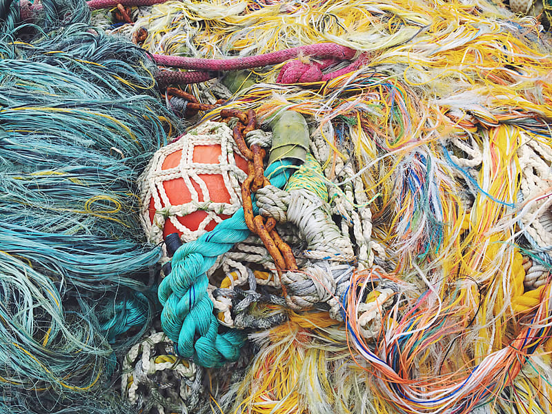Close up of piles of commercial fishing nets and ropes by Paul Edmondson for Stocksy United