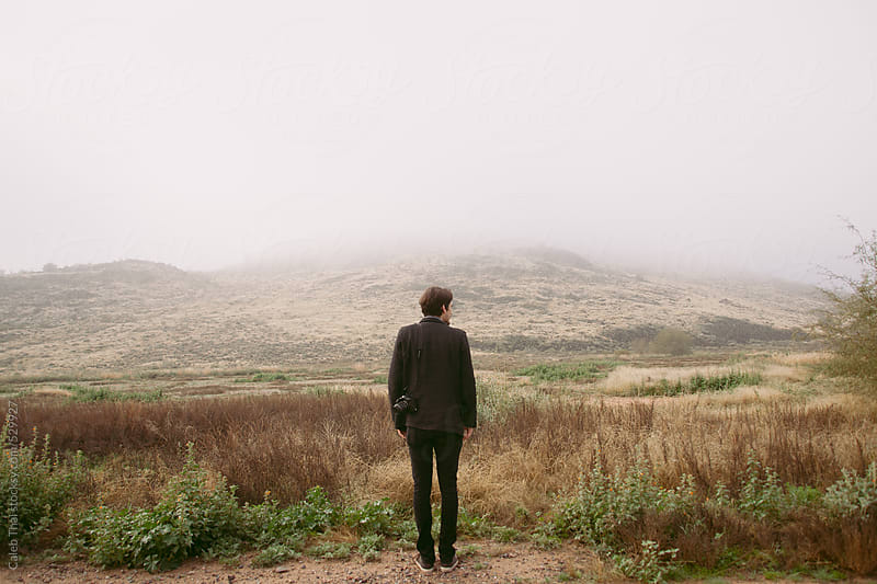 Photographer on A Hill. by Caleb Thal for Stocksy United