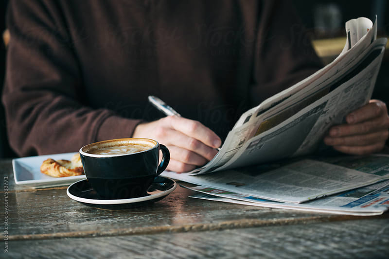 Cafe: Man Looks Through Job Listings In Newspaper by Sean Locke for Stocksy United