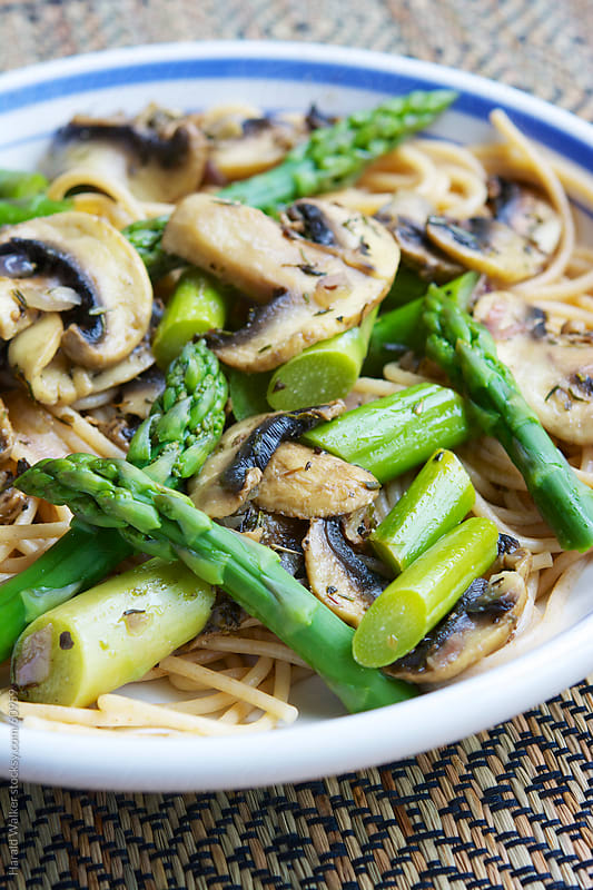 Whole-wheat Pasta with Asparagus and Mushrooms by Harald Walker for Stocksy United