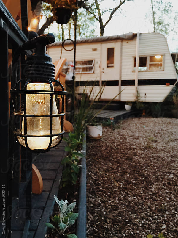Solar lights and trailer in campground by Carey Shaw for Stocksy United