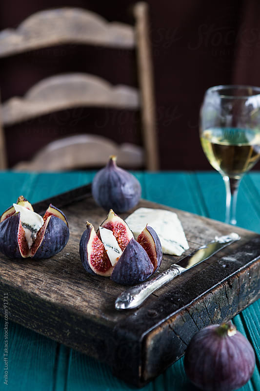 Figs and gorgonzola on an old board by Aniko Lueff Takacs for Stocksy United