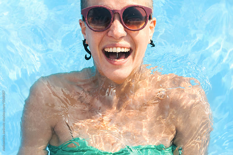Portrait of a Young Woman with Sunglasses at the Swimming Pool by Aleksandra Jankovic for Stocksy United