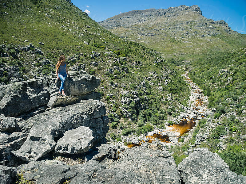 Girl looking down on the Bain's Kloof Gorge or Pass near Capetown South Africa by DV8OR for Stocksy United