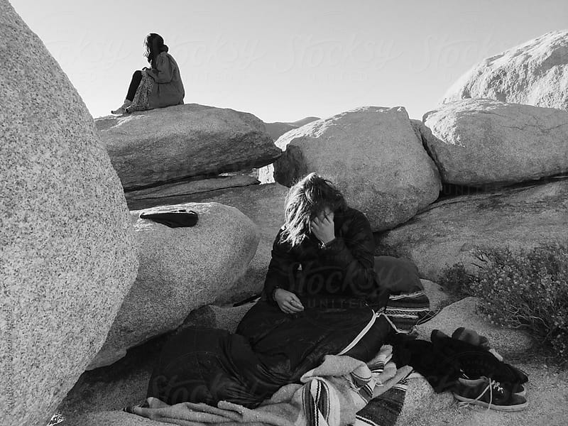 Man Wakes Up on Boulders by Kevin Russ for Stocksy United