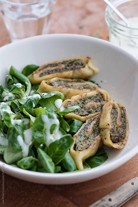 Food: Fried Swabian Ravioli, Maultaschen with Field Salad by Ina Peters for Stocksy United