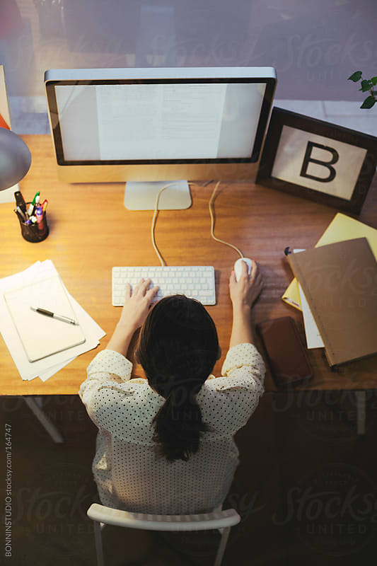 Young woman working on her office at late afternoon. by BONNINSTUDIO for Stocksy United