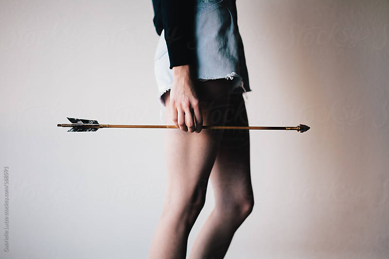 Woman Holding and Arrow - Cropped  by Gabrielle Lutze for Stocksy United