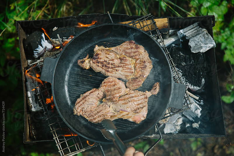 Meat cooked in the pan, from above by Andrey Pavlov for Stocksy United