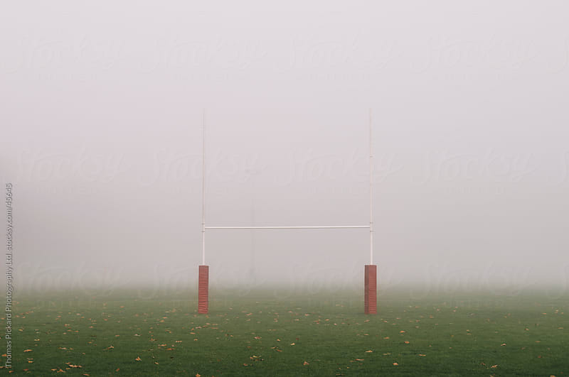 Football goal posts and early morning fog, Christchurch New Zealand by Thomas Pickard for Stocksy United