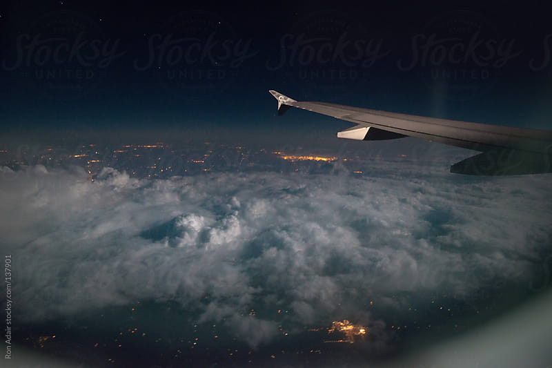 View from Seat 26C flying high above the United States by Ron Adair for Stocksy United