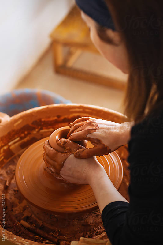 Craftswoman working on a clay vase by Martí Sans for Stocksy United