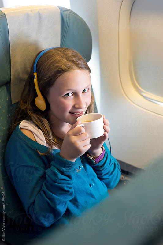 watching tv on a plane by Gillian Vann for Stocksy United