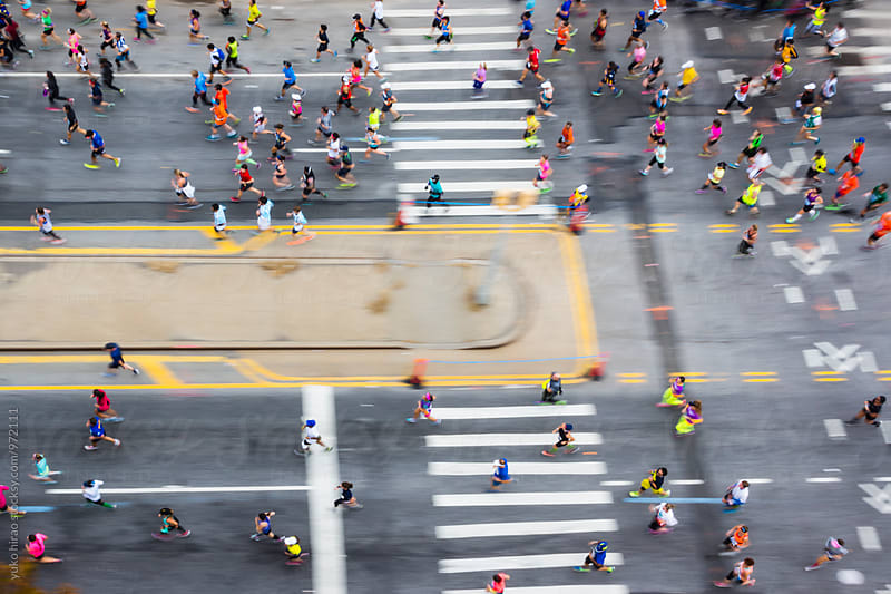 New York City Marathon runners in motion by yuko hirao for Stocksy United