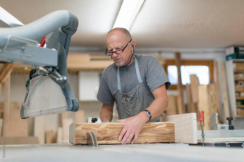 Carpenter working in workshop by Robert Kohlhuber for Stocksy United