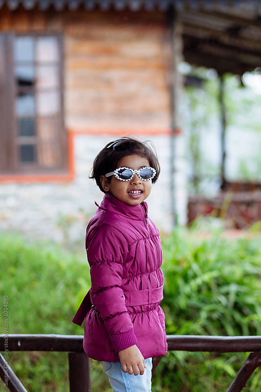 Portrait of little girl wearing sunglasses by Saptak Ganguly for Stocksy United