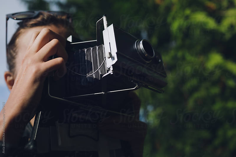 A person taking a picture with an instant camera by Ania Boniecka for Stocksy United