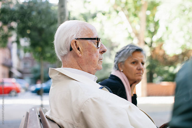 Side view of an elderly man resting on bench outside. by BONNINSTUDIO for Stocksy United