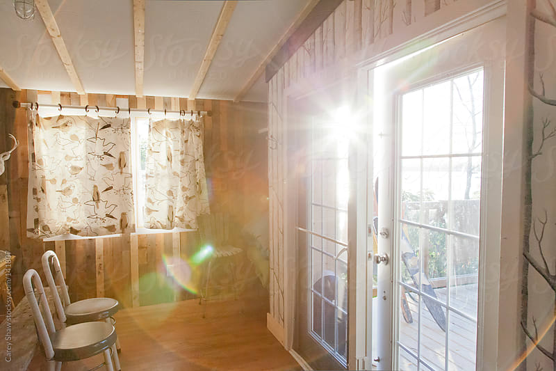 Sun filled cabin  by Carey Shaw for Stocksy United