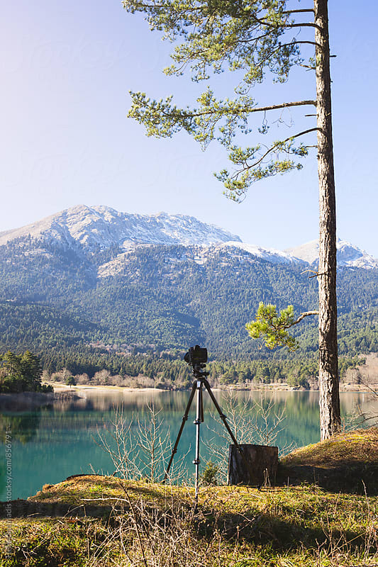 Camera and Tripod at a Lake by Helen Sotiriadis for Stocksy United