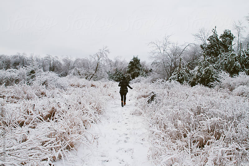 Run down the frozen path by Jesse Morrow for Stocksy United
