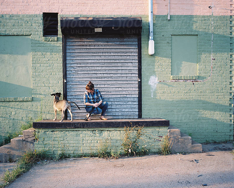Girl and her dog portrai by Cameron Whitman for Stocksy United