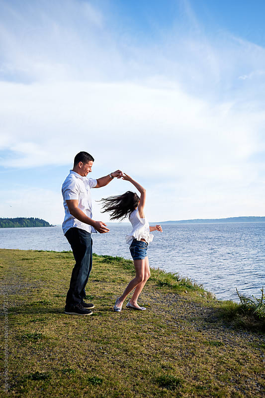 Happy Hispanic father and daughter having fun together on the beach by Suprijono Suharjoto for Stocksy United