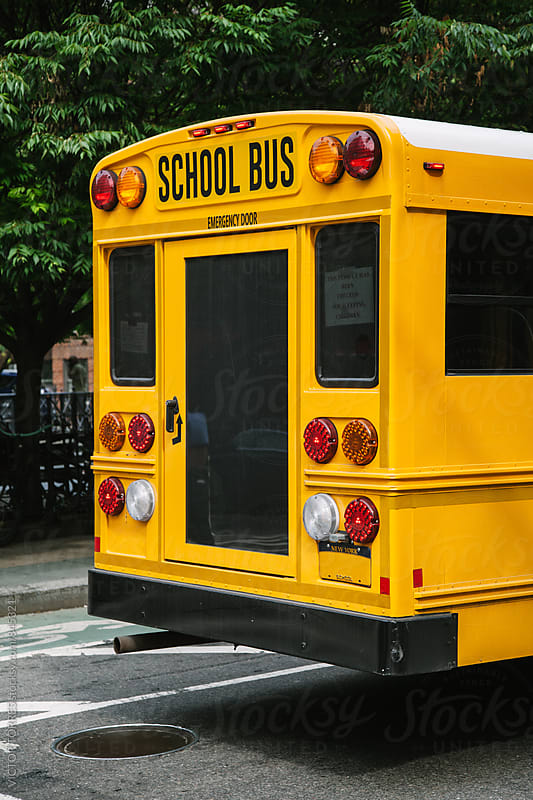 Yellow School Bus in Manhattan Streets by VICTOR TORRES for Stocksy United