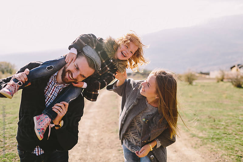 Family have fun by Evgenij Yulkin for Stocksy United