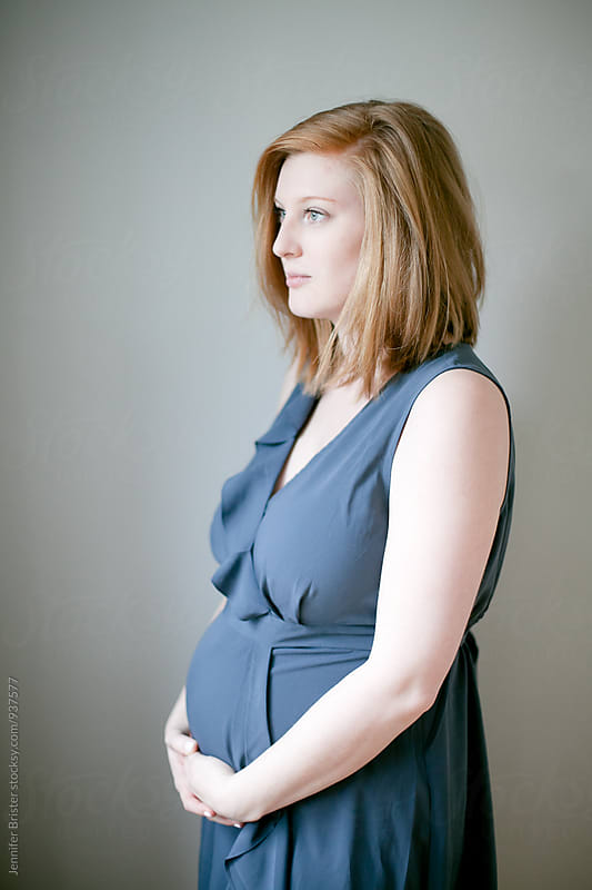 Portrait of a pregnant woman by Jennifer Brister for Stocksy United