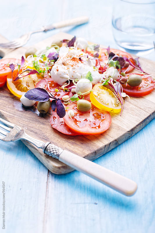 Colorful tomato and mozzarella salad. by Darren Muir for Stocksy United
