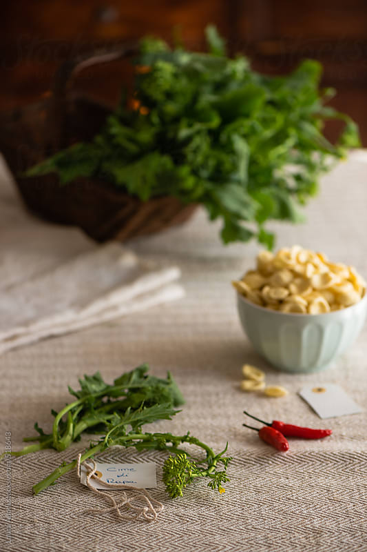 ingredients to make orecchiette with turnip greens by Laura Adani for Stocksy United