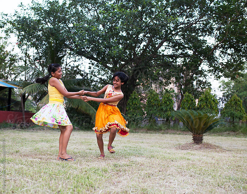 Two girls playing and making fun in outdoor by PARTHA PAL for Stocksy United