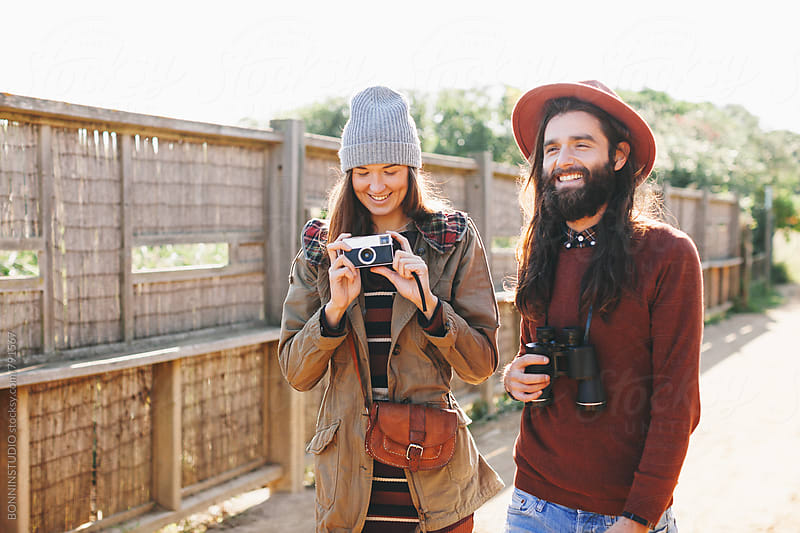 Hipster couple enjoying a sunny day on a wetland. by BONNINSTUDIO for Stocksy United