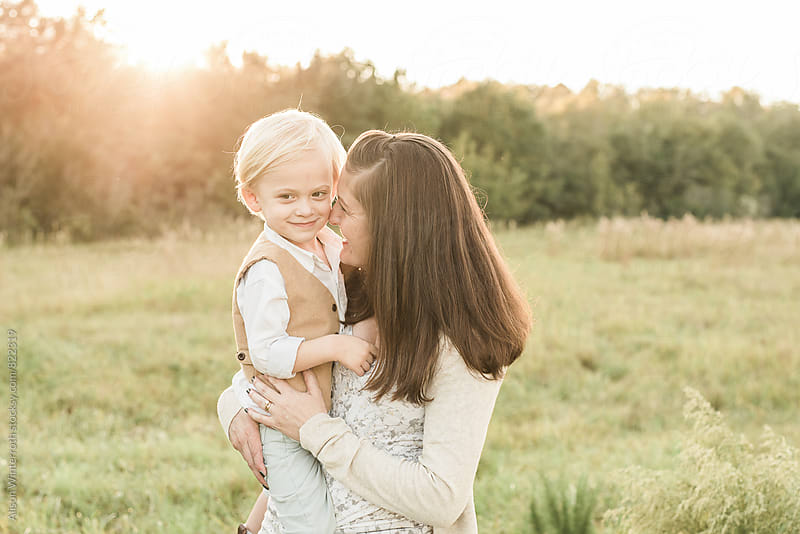 A Mother Smiling At Her Son by Alison Winterroth for Stocksy United