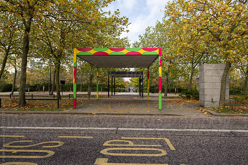 Partially covered walkway in a city centre  by Paul Phillips for Stocksy United