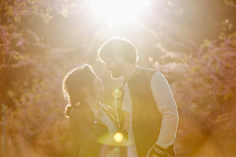 Couple Embracing In Park by ALTO IMAGES for Stocksy United