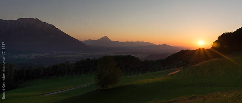 A panorama of green nature landscape near Salzburg at dusk, austria in summer by Robert Kohlhuber for Stocksy United