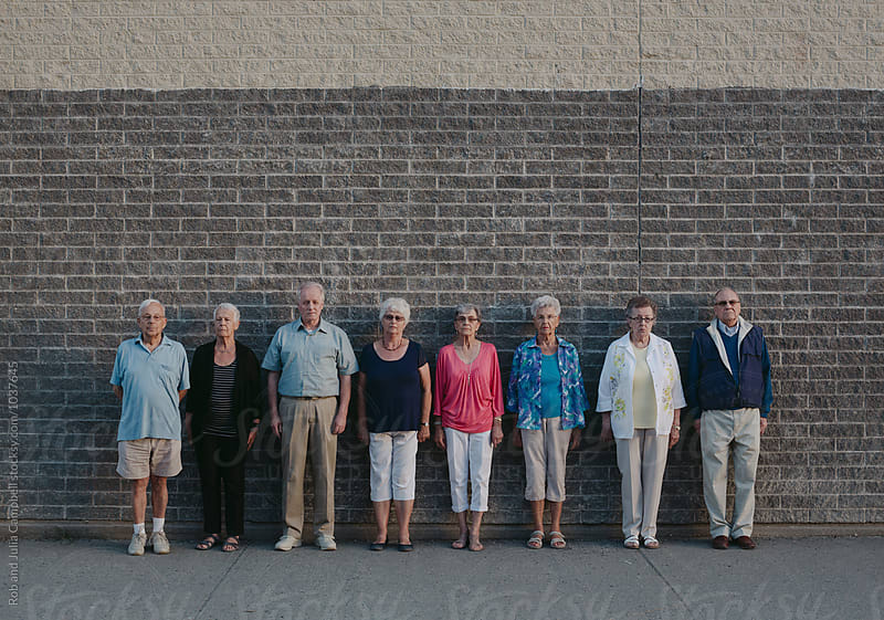 Funny portrait of grumpy caucasian seniors outside at schoolyard by Rob and Julia Campbell for Stocksy United